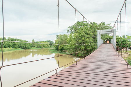 The wooden hanging bridge , mangrove