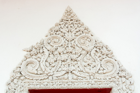 antiquity: flower shape line of old stucco work on Antiquity Temple of Wat Wang ,Phatthalung, Thailand