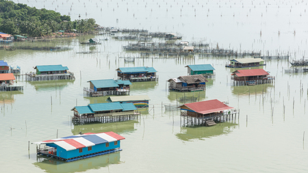 dingy: house of fisherman on Songkhla lake in Thailand with dingy light Stock Photo