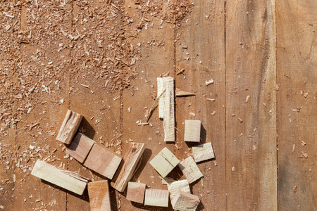 furniture hardware: Home improvement process, saw, timber and ruler on wooden floor Stock Photo