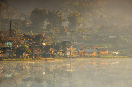 Beautiful view of Ban Rak Thai with reflection on lake, Yunnan Chinese village in Maehongsorn, Thailand. Founded by Kuomintang Chinese soldiers, the village is famous for its breathtaking views and tea cultivation.