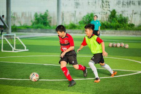 BANGKOK, THAILAND - MAY 6, 2018 :Childrens enjoy playing soccer with coach on holiday at TC football club Rama3.