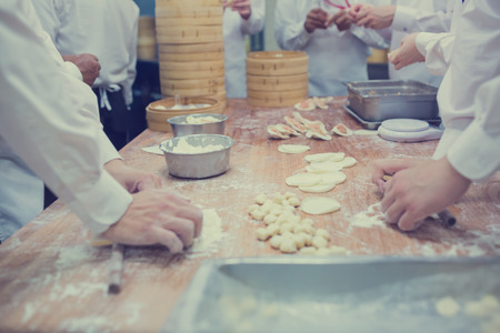 Manufacture of Chinese food by Chinese chefs in restaurant.