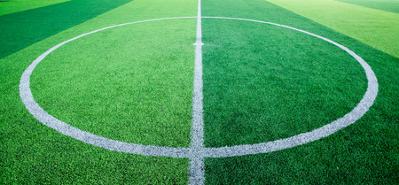 Green background. Centre circle of football field. Stock Photo