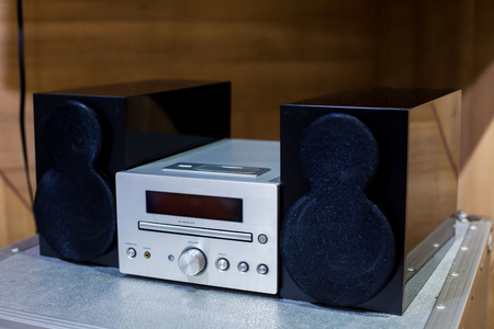 Vintage hi-fi Stereo Amplifier tuner, CD and speakers in wooden cabinets 写真素材