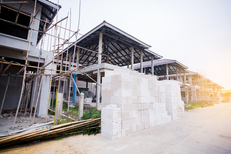 Newly built homes in a residential estate in Thailand. Build with steel truss, lightweight concrete, post and beam framework and Bamboo scaffolding for construction.