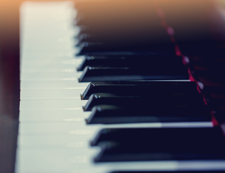 Top view of instrument musical tool. Close up to the piano keyboard background with selective focus. Classical music with black and white key.