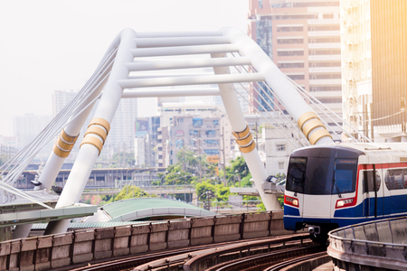 Electric skytrain is running in downtown of Bangkok metropolitan region. It is running on railroad tracks. Editorial