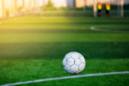 Soft focus of football bounce in front of goal line with blurry soccer player training background. It is not yet goal. It is not yet goal.