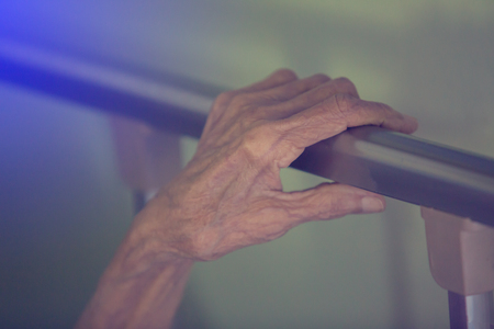 Hand of old woman sleep in bed. Wrinkles of old woman skin Stock Photo