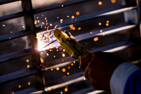 Welder erecting technical steel. Industrial steel welder in factory technical. Welders working at the factory made metal. The conception of under construction. 版權商用圖片 - 113595586