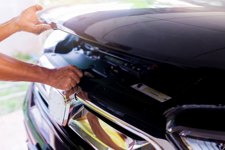 The man opened the hood of car and looking for a malfunction. Service and maintenance of cars or vehicles. Stockfoto