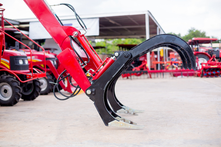 Equipment for sugar cane agriculture. Modern red tractor for Agricultural machinery.