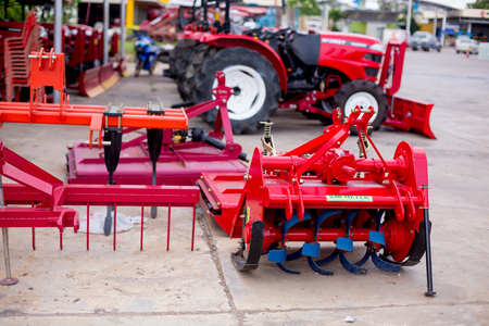 Equipment for soil conditioner agriculture. Modern red tractor for Agricultural machinery.