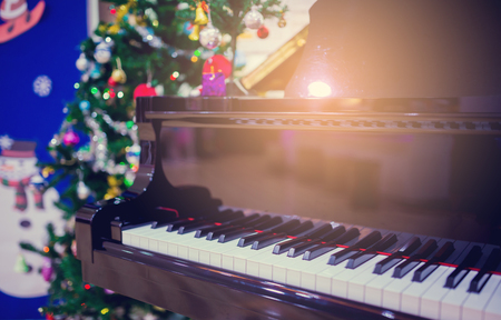 Piano and Christmas tree for christmas holiday background. New Year holidays background. Stock Photo