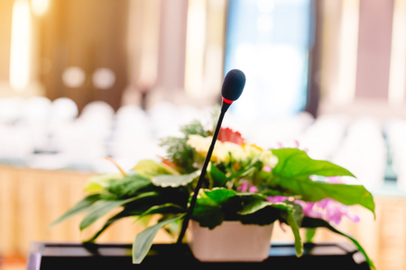 blurry of microphone in an auditorium for shareholders' meeting or seminar event. Archivio Fotografico