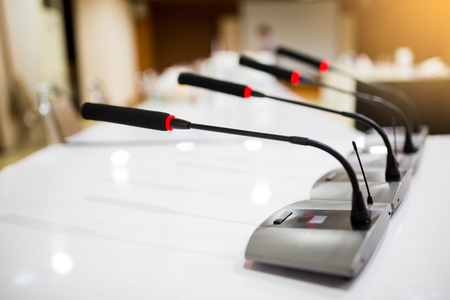 Soft focus of wireless Conference microphones in a meeting room.