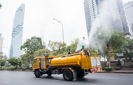 Bangkok Thailand : March 16, 2019 : Municipal officials inject high pressure water into the air on the truck to help reduce the amount of dust PM2.5, Bang Rak District
