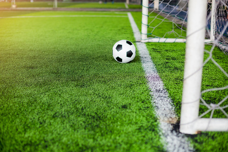 blurry soccer ball on green artificial turf move to goal at front of the goal line. the concept of go to goal. Фото со стока