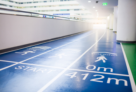 blue running track in grand office building for employees to exercise and relax, Startup concept, Progress concept, Goal creation concept