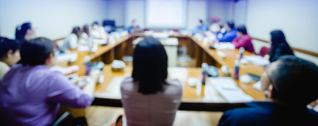 business conference in the meeting room, auditorium for shareholders' meeting or seminar event, many business people listening on the conference, blurry image. Stock Photo