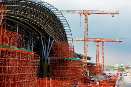 scaffolding in the high altitude, scaffolding formed a myriad of grid, industrial and modern urban construction background. Under construction of metal steel framework outdoors buildings with crane.