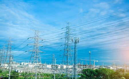 High voltage electric tower line. Power Supply Facilities with blue sky background. transmission tower.