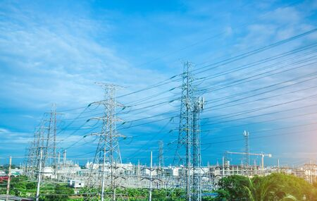High voltage electric tower line. Silhouette of Power Supply Facilities with blue sky background. transmission tower. Standard-Bild