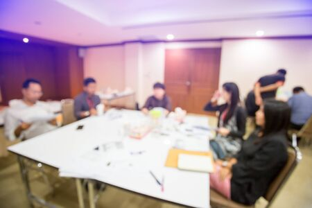 blurry image. startup business team brainstorming on meeting workshop. team working on project together and sharing ideas in workshop. group of multi ethnic corporate people having a business meeting.