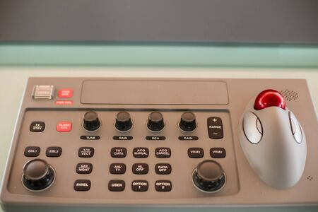 Red ball and press button on panel in control room on international cargo ship in the ocean for communucation and navigater on ocean. Stock Photo
