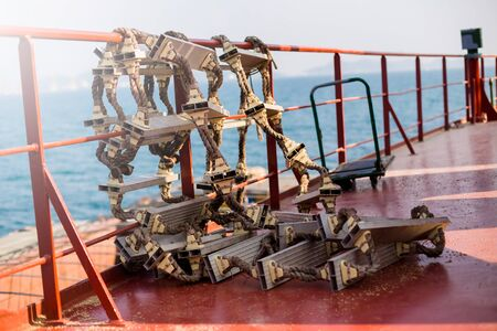 Rope ladder on cargo ship. Shipment from a merchant ship to a small ship.