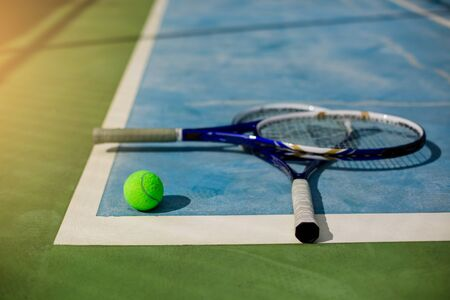 Tennis ball and rackets on tennis court with white line. Tennis game. Sport, recreation concept.