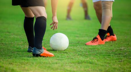 Soccer player get the ball or placing the ball to free kick or penalty kick during match on green grass. Stockfoto
