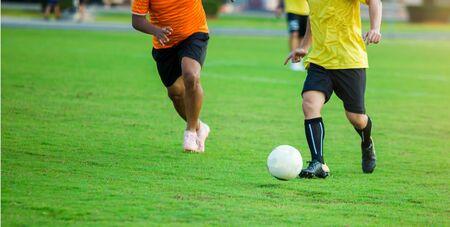 Soccer player speed run to shoot ball to goal on green grass. Soccer player training or football match. Stock fotó
