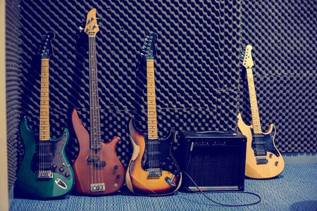 The Electric guitars and bass guitars with amplifiers in the music practice room. Music practice equipment concept.
