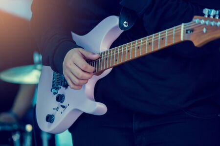 Musician's hands playing Electric guitar at a live show on stage, the concept of musical instrument. Banque d'images - 138504939