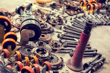 Many tools and old auto spare parts car at a car repair shop. Car parts in old warehouses. Used vehicle part for recycling in the scrap yard garage. Recycle goods/meta.