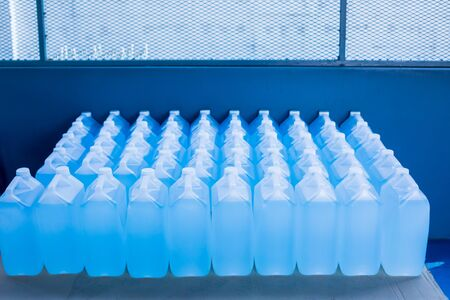 Alcohol for cleaning and sanitizing is contained in gallons in the warehouse. Many gallon alcohol gel for sanitizing Coronavirus Covid-19. Products for sale to anti Coronavirus protection (Covid 19). 版權商用圖片
