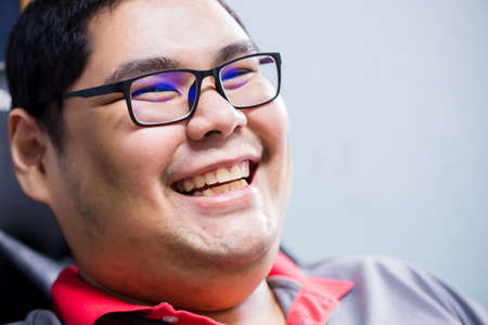 Asian man wearing glasses is laughing happily. The concept of images of happiness. 版權商用圖片