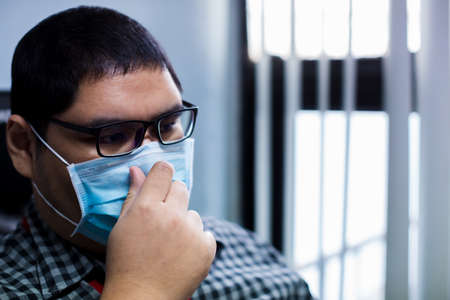 Close up of young man wearing a surgical mask background.