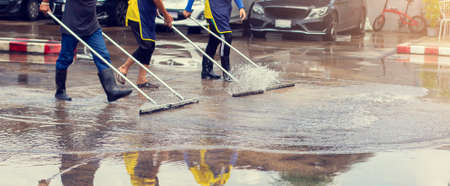 Selective focus to worker using wiper or squeegee to clean floor surface. Staff cleaning floor with wiper. The concept of cleaning service.