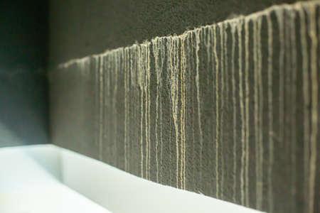 Rain water leak in wall. white water mark on black wall.