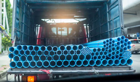 Blue plastic pipe, PVC pipes stacked in truck, PVC water pipes used for construction.