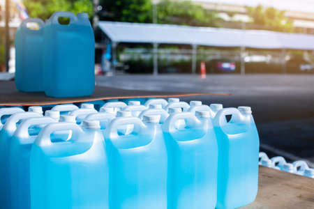 Alcohol for cleaning and sanitizing is contained in gallons in the warehouse.