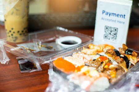 Selective focus to Sushi set or Japanese food with blur QR code payment tag. Qr code payment concept. Zdjęcie Seryjne