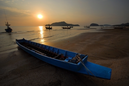 Small fishing boats on the beach in the morning Samroyyod beach Prachuap Khiri Khan Thailand  photo