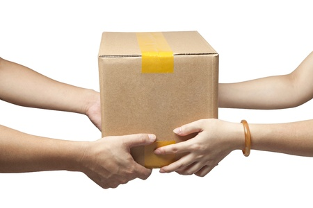 deliver: Close-up of the hands of two people holding a box