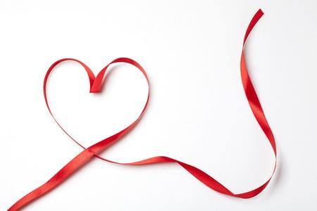 Red ribbon in heart shape