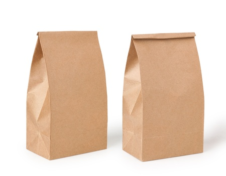 closeup on bags:  brown lunch bag isolated on white background