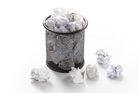 wastepaper: Overflowed wastepaper basket